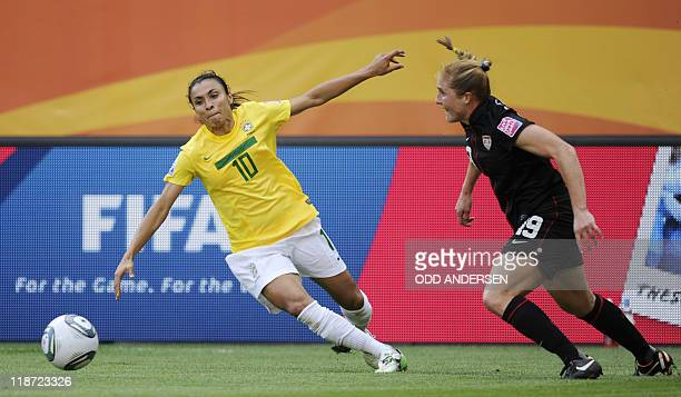 Brazil's striker Marta and USA's defender Rachel Buehler vie for the ball during the quarterfinal match of the FIFA women's football World Cup Brazil...
