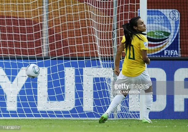 Brazil's striker Marta celebrates after scoring the 11 by penalty during the quarterfinal match of the FIFA women's football World Cup Brazil vs USA...