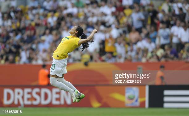 Brazil's striker Marta celebrates after scoring the 21 during the quarterfinal match of the FIFA women's football World Cup Brazil vs USA on July 10...