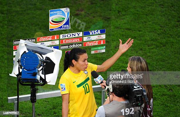 Brazil's striker Marta gives an interview after the quarterfinal match of the FIFA women's football World Cup Brazil vs USA on July 10 2011 in...