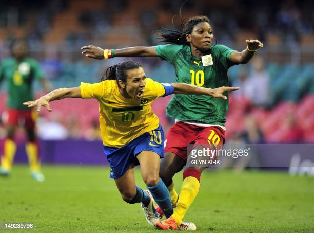 Brazil's striker Marta is fouled by Cameroon's striker Bebey Beyene for a penalty during their London 2012 Olympic women's football match between...