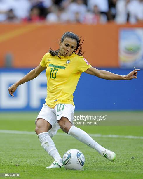 Brazil's striker Marta shoots a penalty to score the 11 during the quarterfinal match of the FIFA women's football World Cup Brazil vs USA on July 10...