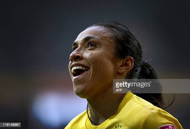 Brazil's striker Marta smiles as she walks over to take a corner kick during Group D the FIFA women's football World Cup Brazil vs Norway in...