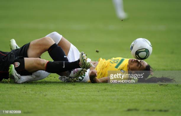 Brazil's striker Marta vies for the ball with an unidentified player of the US during the quarterfinal match of the FIFA women's football World Cup...