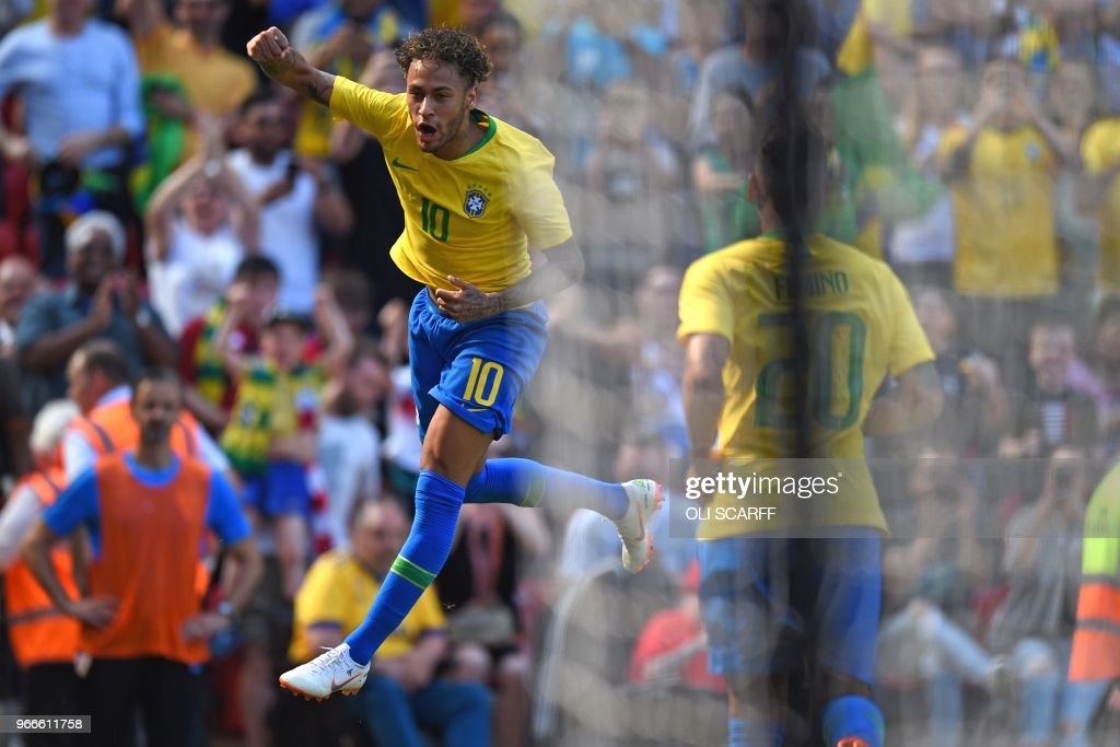TOPSHOT - Brazil's striker Neymar celebrates after scoring the opening goal of the International friendly football match between Brazil and Croatia at Anfield in Liverpool on June 3, 2018.
