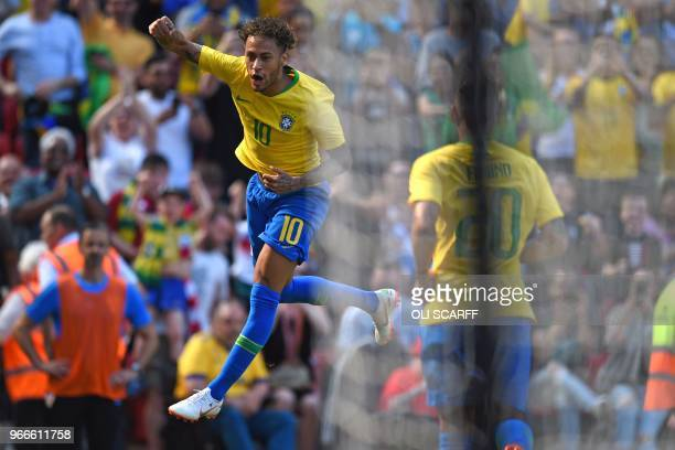 TOPSHOT Brazil's striker Neymar celebrates after scoring the opening goal of the International friendly football match between Brazil and Croatia at...