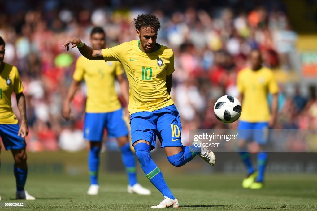TOPSHOT - Brazil's striker Neymar controls the ball during the International friendly football match between Brazil and Croatia at Anfield in Liverpool on June 3, 2018.