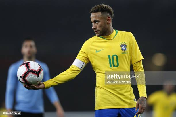 Brazil's striker Neymar holds out the ball during the international friendly football match between Brazil and Uruguay at The Emirates Stadium in...
