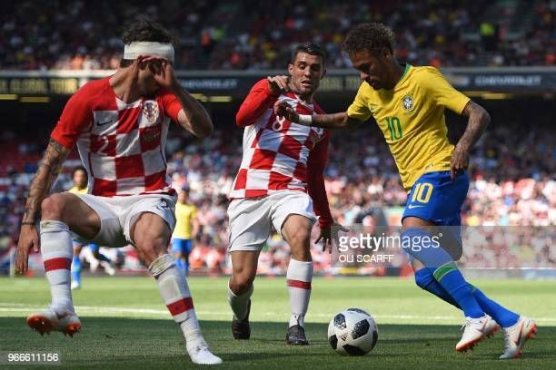 TOPSHOT Brazil's striker Neymar vies with Croatia's defender Sime Vrsaljko and Croatia's midfielder Mateo Kovacic in the build up to scoring the...