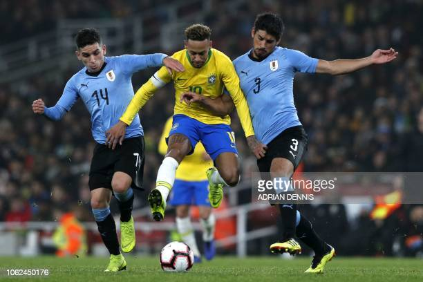 Brazil's striker Neymar vies with Uruguay's midfielder Lucas Torreira and Uruguay's defender Bruno Mendez during the international friendly football...