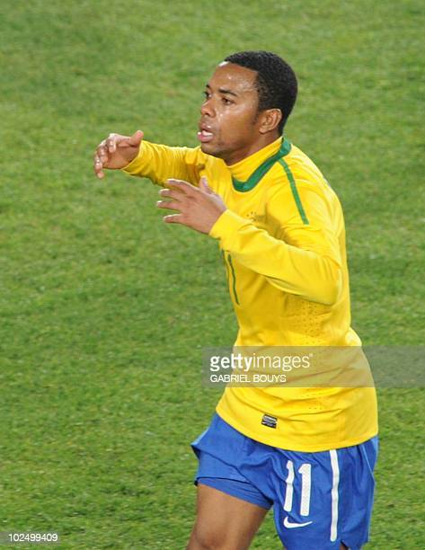 Brazil's striker Robinho celebrates after scoring his team's third goal during the 2010 World Cup round of 16 football match Brazil vs. Chile on June...