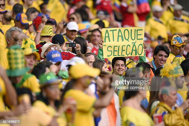 Brazil's supporters cheer prior to the quarterfinal football match between Brazil and Colombia at the Castelao Stadium in Fortaleza during the 2014...
