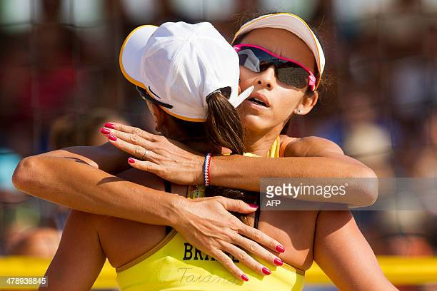 Brazil's Taiana and Talita celebrate after winning to Argentina in the X South American Games beach volley final match in Santiago on March 15 2014...