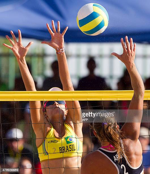 Brazil's Talita blocks the ball to Argentina's Georgina Klut during the X South American Games beach volley final match in Santiago on March 15 2014...