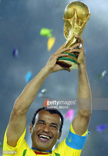 Brazil's team captain and defender Cafu hoists the World Cup trophy after Brazil won 20 against Germany in match 64 of the 2002 FIFA World Cup Korea...