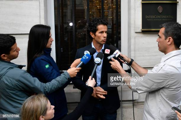 Brazil's team doctor Rodrigo Lasmar answers journalists' questions after Brazilian defender Dani Alves was ruled out of the World Cup on May 11 2018...