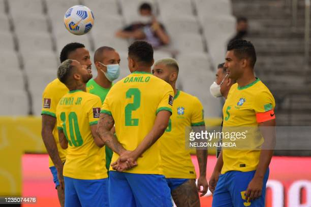 Brazil's team players are seen after employees of the National Health Surveillance Agency entered to the field during the South American...