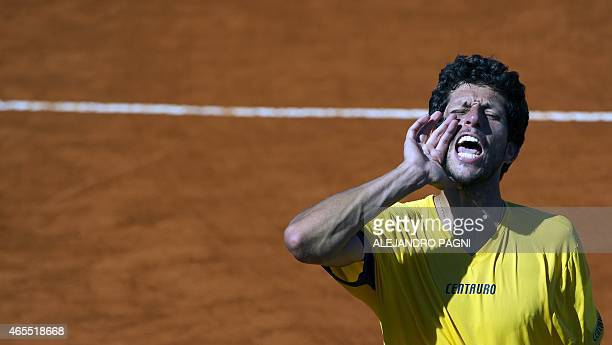 Brazil's tennis player Marcelo Melo gestures after winning to Argentina's Carlos Berlocq and Diego Schwartzman with teammate Bruno Soares by 75 63...