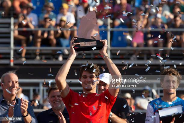 Brazil's Thiago Seyboth Wild holds the trophy after after winning the ATP World Tour Santiago Open 2020 final match against Norway's Casper Ruud in...