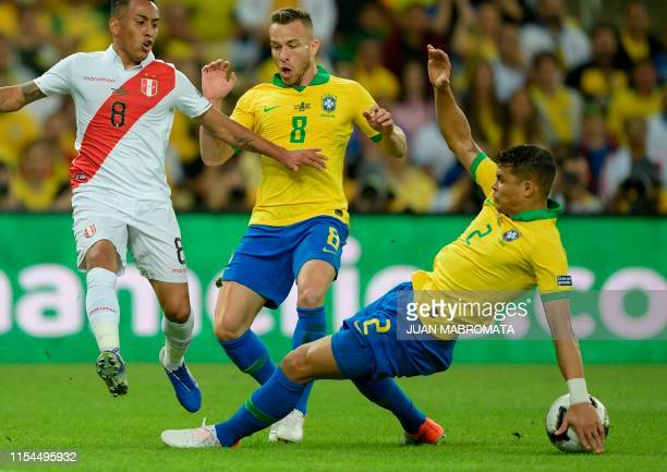 Brazil's Thiago Silva diverts the ball with his hand as Peru's Christian Cueva and Brazil's Arthur look on during their Copa America football...
