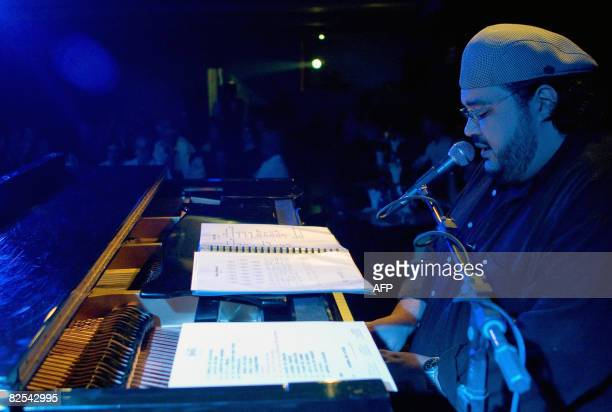 Brazil's 'Turma da Bossa' pianist Gustavo Rocha performs early in the morning on August 25 2008 at the 'Bar do Tom' in Rio de Janeiro during...