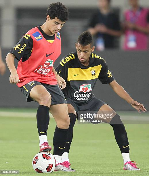 Brazil's two new stars Coutinho and Neymar attend a training session in Doha on November 16 2010 ahead of their team's friendly football match...