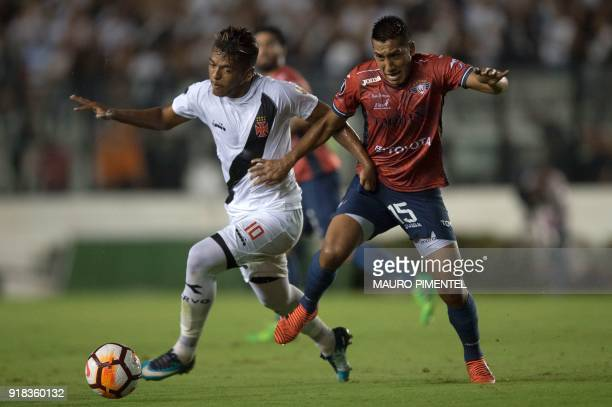 Brazil's Vasco da Gama player Evander drives the ball past Christian Machado of Bolivia's Jorge Wilstermann during their Libertadores Cup football...