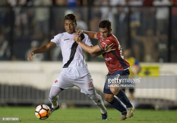 Brazil's Vasco da Gama player Evander vies for the ball with Fernando Saucedo of Bolivia's Jorge Wilstermann during their Libertadores Cup football...