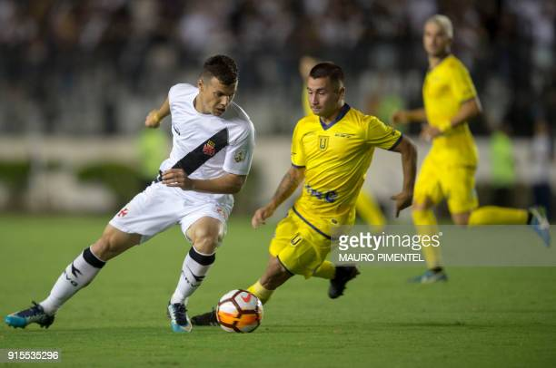 Brazil's Vasco da Gama player Wagner vies for the ball with Chile's Universidad Concepcion player Jean Meneses during a Libertadores Cup football...