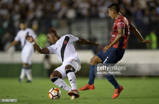 Brazil's Vasco da Gama player Wellington is marked by Christian Machado of Bolivia's Jorge Wilstermann during their Libertadores Cup football match...