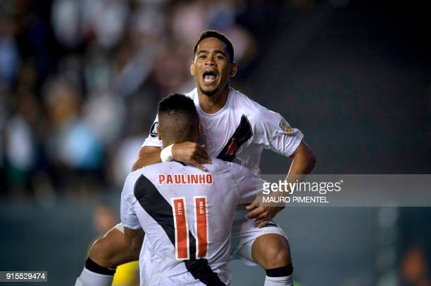 Brazil's Vasco da Gama player Yago Pikachu celebrates with his teammate Paulinho after scoring a goal against Chile's Universidad Concepcion during...