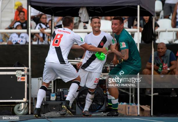 Brazil's Vasco da Gama player Yago Pikachu celebrates with his teammates after scoring a goal against Brazil's Botafogo team during the first final...