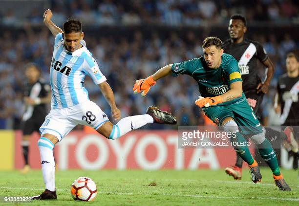 Brazil's Vasco da Gama Uruguayan goalkeeper Martin Silva fails to stop Argentina's Racing Club midfielder Matias Zaracho who controls the ball and...