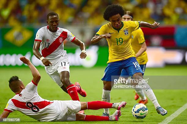 Brazil's Willian controls the ball next to Peru's Christian Cueva and Luis Advincula during their Russia 2018 FIFA World Cup South American...