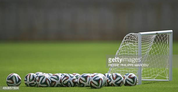 Brazuca balls are picture during a training session of the Cameroon team at the Kleber Andrade stadium in Vitoria on June 15 2014 during the 2014...