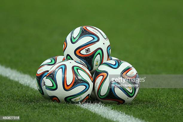 'Brazuca' balls sit on the pitch during an England training session ahead of the 2014 FIFA World Cup Brazil match against Uruguay at Arena de Sao...
