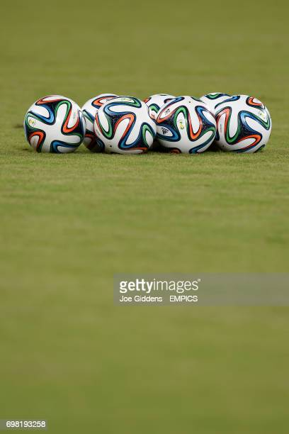 Brazuca footballs on the pitch before a training session at Arena das Dunas in Natal