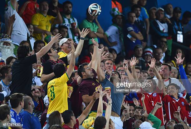 A 'Brazuca' match ball flies into the crowd during the 2014 FIFA World Cup Brazil Group H match between Algeria and Russia at Arena da Baixada on...