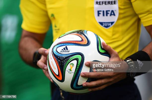 A 'Brazuca' match ball is held by an official prior to the 2014 FIFA World Cup Brazil Group C match between Greece and the Ivory Coast at Castelao on...