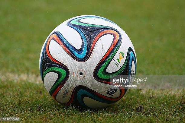 A 'Brazuca' match ball sits on the pitch during the 2014 FIFA World Cup Brazil group G match between the United States and Germany at Arena...