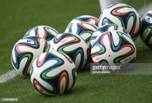 Brazuca soccer balls lie on the pitch during a training session of the Portugues national soccer team in Salvador Brazil XX June 2014 The FIFA World...