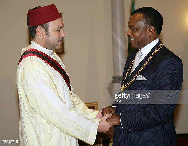 President Denis Sassou Nguesso and chairman of the African Union greets King Mohammed VI of Morocco before convening at a dinner in Brazzavile 22...