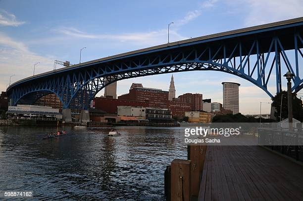 brdge over the riverbank, cuyahoga river, flats entertainment neighborhood, cleveland, ohio, usa - cuyahoga river stock photos and pictures