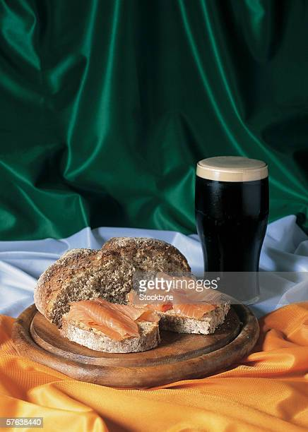 Bread and a glass of beer lying on the Irish flag
