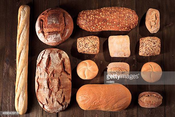 Bread and buns on wooden table, Bakeries