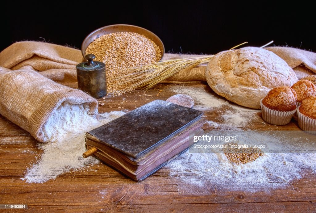 Bread And Flour On A Rustic Wooden Table : Stock-Foto