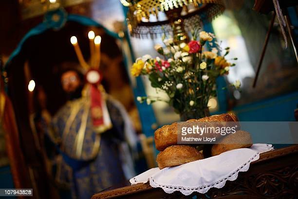 Bread and flowers sit on a table as His Eminence Gregorios Archbishop of Thyateira and Great Britain presides over the divine liturgy at the Parish...