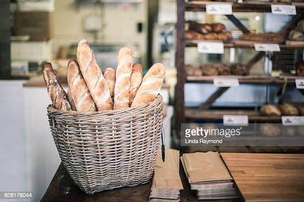 bread baguette in a bakery - baguette stock pictures, royalty-free photos & images