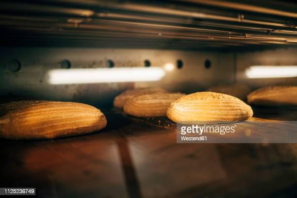 Bread baking in oven in a bakery