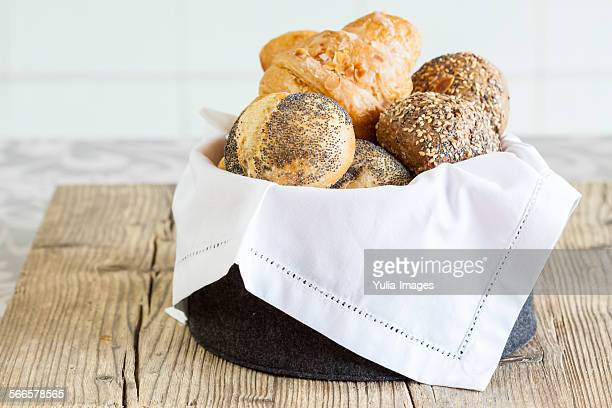 Bread basket with assorted rolls and croissants